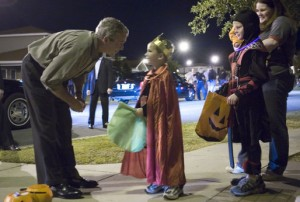 There's a sense of joy and fun on Halloween night as children roam in colorful costumes and interact with their neighbors.